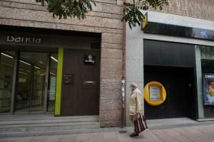 Los bancos españoles Caixabank y Bankia aprueban su fusión